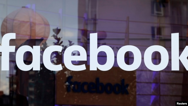 The logo of Facebook is pictured on a window at new Facebook Innovation Hub during a media tour in Berlin, Germany, Feb. 24, 2016. The German court ruling will now allow Facebook to block people using fake names.