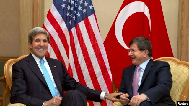 U.S. Secretary of State John Kerry (L) meets with Turkey's Foreign Minister Ahmet Davutoglu before attending the Association of Southeast Asian Nations (ASEAN) security meetings in Bandar Seri Begawan, July 2, 2013.