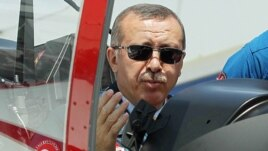 Turkish Prime Minister Recep Tayyip Erdogan in the cockpit of Hurkus (Freebird), Turkey's first locally produced military training plane, outside Ankara, Turkey, June 27, 2012 (AP).