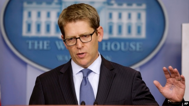 White House press secretary Jay Carney gestures during his daily news briefing where he spoke about the budget and partial government shutdown, at the White House in Washington, Oct. 11, 2013.