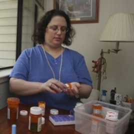 Melody Nolan, who suffers from systemic lupus, prepares her daily medications at her home in Sacramento, California