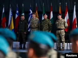 From left, Anton Waldner, new major general of European Forces; Adrian Bradshaw, general of European Forces; Mikhail Kostarakos, chairman of the European Union Military Committee; and James Rupert Everard, general of European Forces, attend a EUFOR change-of-command ceremony in Sarajevo, Bosnia and Herzegovina, March 28, 2017.
