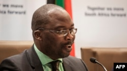 South Africa's Justice Minister Michael Masutha gives a press briefing in Pretoria on Oct. 21, 2016 regarding the country's decision to withdraw from the International Criminal Court (ICC).