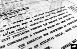 "FILE - Part of a file from the CIA, dated Oct. 10, 1963, details ""a reliable and sensitive source in Mexico"" report of Lee Harvey Oswald's contact with the Soviet Union embassy in Mexico City, that was released for the first time on Nov. 3, 2017."