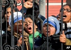 FILE - Indian Christians shout slogans protesting attacks on churches in the Indian capital as they assemble outside the Sacred Heart Church in New Delhi, India, Feb. 5, 2015.