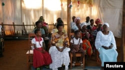 Worshipers attend Sunday service in Bujumbura, Burundi, July 19, 2015.