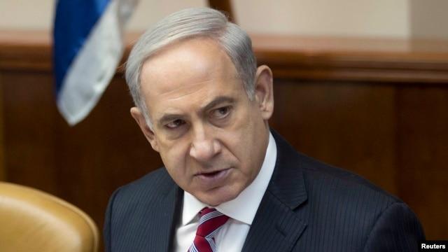Israel's Prime Minister Benjamin Netanyahu attends the weekly Cabinet meeting in Jerusalem, June 9, 2013.