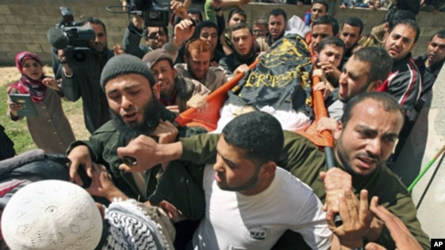 Palestinians carry the body of Islamic Jihad militant Saber Asalya during his funeral at Jabalya refugee camp in the northern Gaza Strip after Israeli aircraft killed two Palestinian militants, one of them Asalya, March 27, 2011
