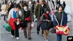 Djeca evakuirana iz blizine elektrane Fukushima, u ožujku 2011.