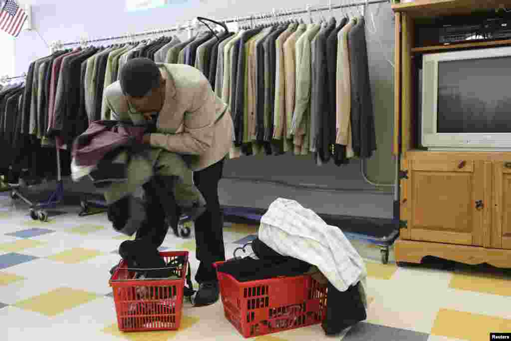 A U.S. military veteran Doyle Colbert fills a basket with clothing at St. Anthony Foundation in San Francisco, California, Nov. 8, 2013.