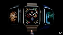 Apple CEO Tim Cook discusses the new Apple Watch 4 at the Steve Jobs Theater during an event to announce new products Wednesday, Sept. 12, 2018, in Cupertino, Calif. (AP Photo/Marcio Jose Sanchez)