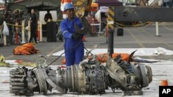 Officials move an engine recovered from the crashed Lion Air jet for further investigation in Jakarta, Indonesia, Nov. 4, 2018.