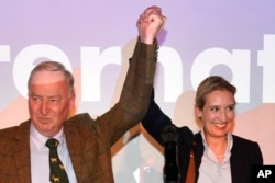 AfD top candidates Alexander Gauland, left, and Alice Weidel celebrate with their supporters during the election party of the nationalist 'Alternative for Germany', AfD, in Berlin, Sept. 24, 2017.
