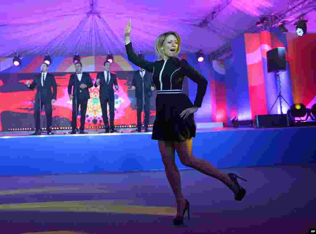 Russian Foreign Ministry spokeswoman Maria Zakharova dances 'Kalinka', one of the most well-known Russian folk songs, during a reception for journalists at the ASEAN - Russia summit in the Black Sea resort of Sochi, Russia, May 19, 2016.