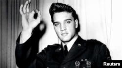 Singer Elvis Presley wearing his United States Army uniform.