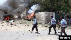 Somali policemen take up position near the scene of a deadly blast in Mogadishu Apr. 14, 2013.