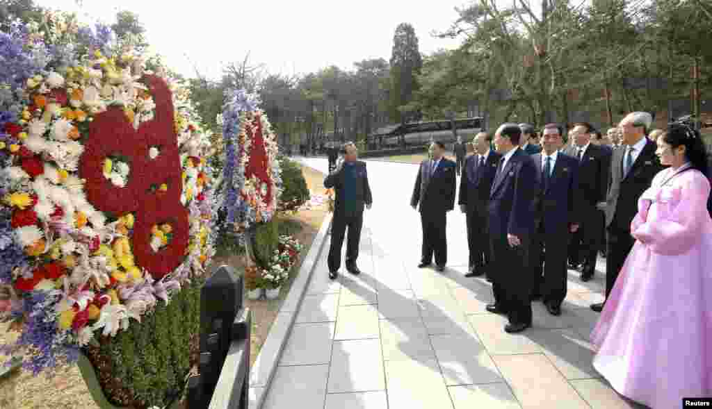 North Korean party officials visit Mankyongdae, the birthplace of North Korean founder Kim Il-sung, on the 101st anniversary of his birth, April 15, 2013.