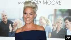 "FILE - In this Monday, Sept. 16, 2013 file photo, Alecia Moore aka Pink arrives at the premiere of ""Thanks for Sharing"" at the ArcLight Hollywood, in Los Angeles."
