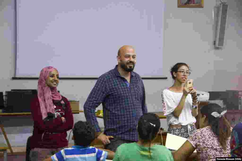 John Milad is seen during one of his workshops for African refugees in Cairo, Egypt, July 22, 2017.