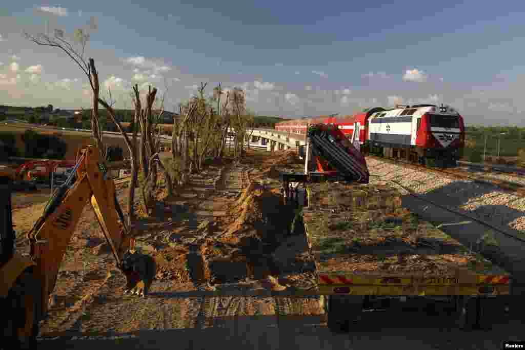 Trees are planted to obscure the view of passing trains to prevent possible attacks by militants in the nearby Gaza Strip, near the southern town of Sderot, Sept. 2, 2014.
