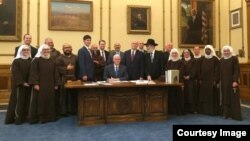 Handout photo from Indiana Governor Mike Pence's office on the signing of the RFRA on March 26.
