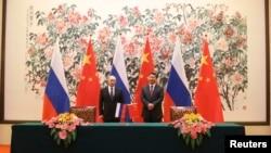 2014年11月9日中國國家主席習近平與俄羅斯總統普京於北京釣魚台賓館。(資料照)