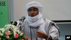 FILE - Mossa Ag Attaher, spokesman for the National Movement for the Liberation of Azawad, speaks during a press conference in Rabat, Morocco, Jan. 23, 2014.
