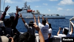 FILE - A Chinese Coast Guard vessel manoeuvres to block a Philippine government supply ship with members of the media aboard at the disputed Second Thomas Shoal, part of the Spratly Islands, in the South China Sea.