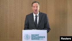 MI6 chief Alex Younger speaks at MI6's Vauxhall Cross headquarters in central London, in this still image from video, Dec. 8, 2016. Younger said Britain and Western nations are facing grave threats to their security and political systems from hostile propaganda output and cyber attacks.