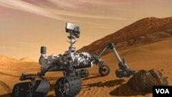 Gambar ilustrasi rover Mars milik NASA 'Curiosity' yang diperkirakan akan sampai di permukaan Mars bulan Agustus 2012.