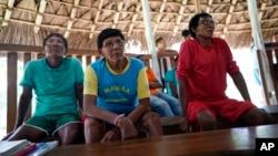 FILE - Indigenous elders attend a hearing on the Waimiri-Atroari reserve in Brazil's Amazon state, Feb. 27, 2019.