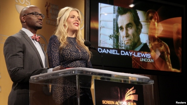 "Daniel Day-Lewis is announced as a nominee for Outstanding Performance by a Male Actor in a Leading Role for ""Lincoln"" as actors Taye Diggs (L) and Busy Philipps announce the nominations for the 19th Annual Screen Actors Guild Awards in West Hollywood, Ca"