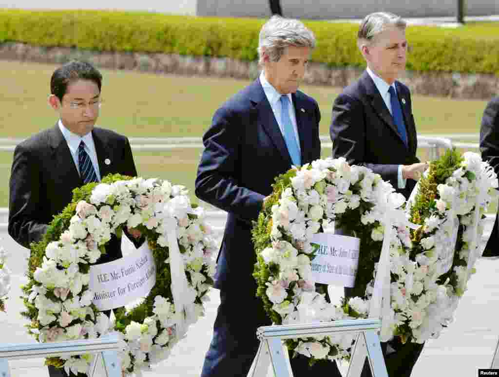 U.S. Secretary of State John Kerry (2nd L) prepares to lay a wreath at the cenotaph with Japan's Foreign Minister Fumio Kishida (L), Britain's Foreign Minister Philip Hammond and other fellow G7 foreign ministers at Hiroshima Peace Memorial Park and Museum in Hiroshima, in this photo released by Kyodo April 11, 2016.