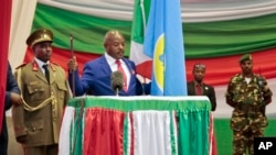 FILE - Burundi's President Pierre Nkurunziza is sworn in for a third term at a ceremony in the parliament in Bujumbura, Aug. 20, 2015.