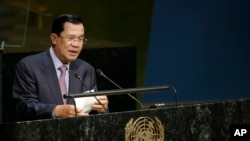 FILE - Cambodian Prime Minister Hun Sen speaks at the United Nations, Sept. 26, 2015. Expatriates are urging sanctions against his government for suppression of dissent and the jailing of opposition members and rights workers.
