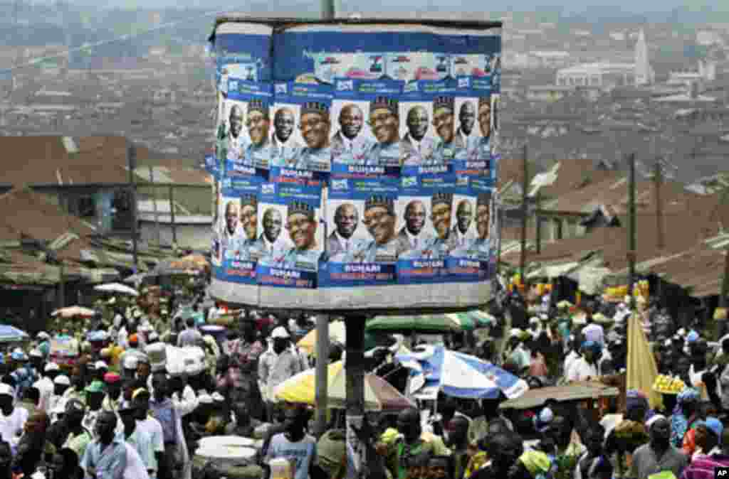 An advertisement tank is plastered with posters of former military ruler Muhammadu Buhari and his running mate Tunde Bakare during the Congress for Progressive Change (CPC) presidential campaign rally at Mapo square, Ibadan, south-west Nigeria, Mar 14 20