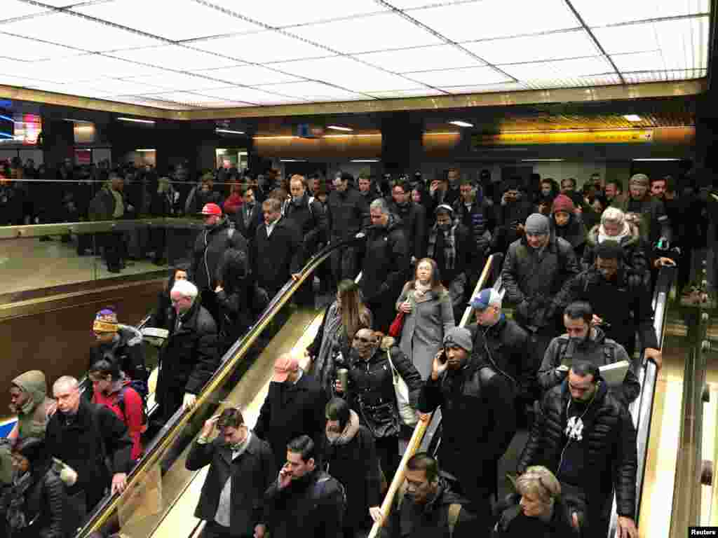 Commuters exit the New York Port Authority in New York City, U.S. Dec. 11, 2017 after reports of an explosion.