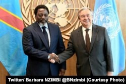 FILE - Democratic Republic of Congo President Joseph Kabila and U.N. Secretary-General Antonio Guterres shake hands during the U.N. General Assembly, New York, Sept. 23, 2017.
