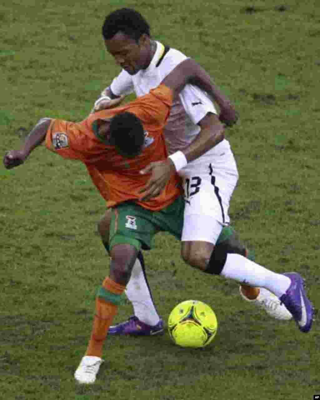 "Jordan Ayew of Ghana (R) fights for the ball with Rainford Kalaba of Zambia during their African Nations Cup semi-final soccer match at Estadio de Bata ""Bata Stadium"" in Bata February 8, 2012."