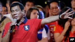 Philippine presidential race front-runner, Davao city mayor Rodrigo Duterte, gestures during his final campaign rally in Manila, Philippines, May 7, 2016. A surprise favorite, Duterte is surprise favorite. Duterte is known for his profanity-filled speeches against the government.
