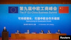 European Council President Herman Van Rompuy, left, speaks next to Chairman of the China International Trade Promotion Committee Wan Jifei, second left, during the 9th EU-China Business Summit, Great Hall of the People, Beijing, Nov. 21, 2013.
