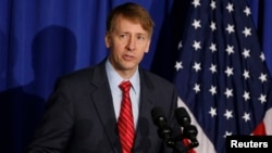 Consumer Financial Protection Bureau Director Richard Cordray speaks in Washington, Oct. 17, 2014. Cordray resigned Nov. 24, 2017, and simultaneously named his successor, setting up the consumer agency for another battle with the Trump White House over control of the powerful federal watchdog.
