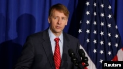 Consumer Financial Protection Bureau Director Richard Cordray speaks in Washington, Oct. 17, 2014.