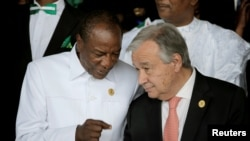 Guinea's President and AU President Alpha Conde talks to UN Secretary-General Antonio Guterres at the 30th Ordinary Session of the Assembly of the Heads of State and the Government of the AU in Addis Ababa, Jan. 28, 2018.