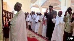FILE - A photo taken on November 20, 2013 shows Imam Dalil Hayatou (L), leading the prayers at the Great Mosque in Maroua's Dougoi district, northern Cameroon.