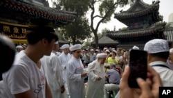 Baadhi ya waumini wa kiislamu katika sherehe za Eid Al Haji