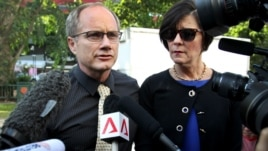 Parents of the late American Shane Todd, Mary, right, and Rick Todd, left, arrive to waiting press at the Subordinate Courts, May 13, 2013, in Singapore.