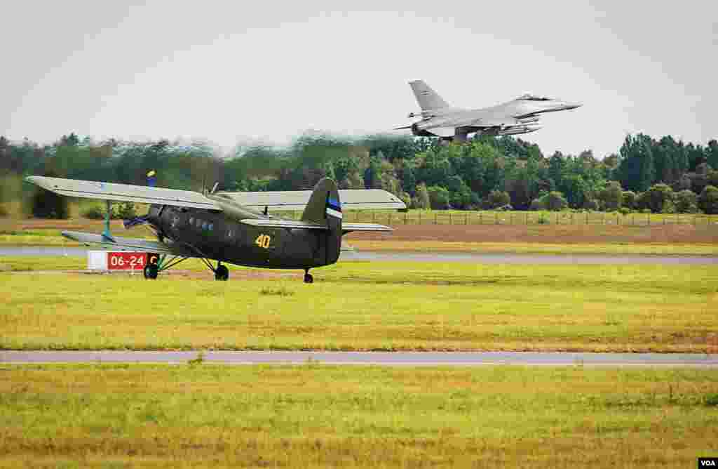 At Estonia's Amari Airbase, a Danish F-16 fighter jet takes off from a newly renovated NATO standard base. Waiting to take off is a Soviet era AN-2 biplane, one of two fixed wing aircraft in Estonia's fledgling air force. (Vera Undritz/VOA)