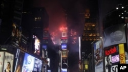 Fireworks erupt from a building to signal the New Year, 2011, in Times Square in New York, 01 Jan 2011