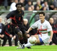 Mbo Mpenza (L) of Belgium is tackled by Rafik Saifi (R) of Algeria during their friendly match at the King Baudouin stadium in Brussels, May 14, 2002. Belgium played Algeria in preparation for the South-Korea/Japan World Cup in June this year. (Reuters | Yves Herman).
